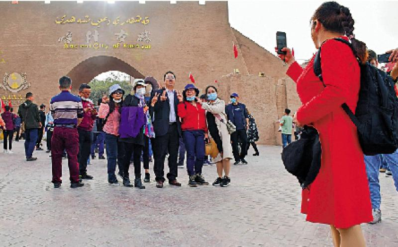 海外专家:黄金周折射中国经济回暖